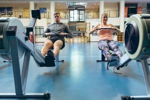 two people working out on exercise equipment