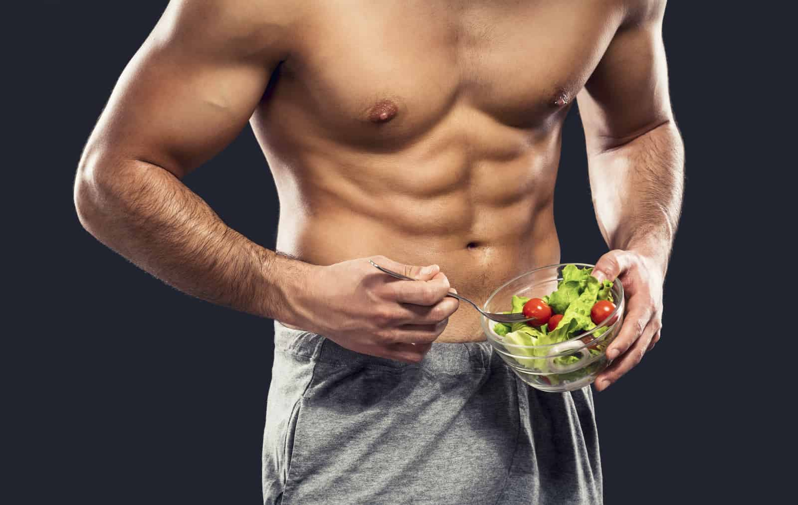 rowing machine workout weight loss results on a male holding a bowl of salad