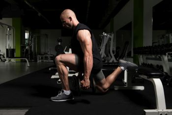 man at guy doing a lung to build up glutes