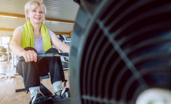 lady working out on in home exercise equipment for seniors