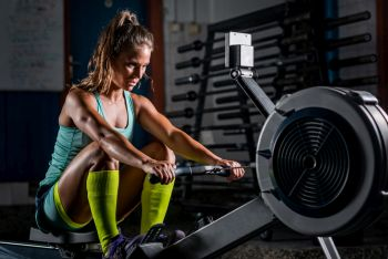 lady exercising at gym performing indoor rower training plan
