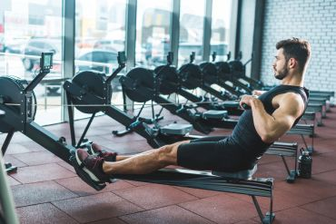 man showing proper seated row form